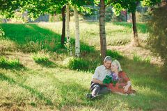 Happy and very old people sitting in the park.  royalty free stock photo