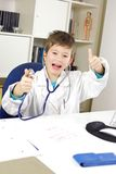 Happy very young doctor thumb up in office Stock Photography