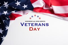 Happy Veterans Day. American flags with the text thank you veterans against a white background. November 11