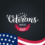 Happy Veterans Day lettering with USA flag vector illustration. November 11 holiday background. Celebration poster. Stock Photo