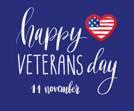 Happy Veterans Day lettering for your design. Vector illustration of calligraphy phrase Happy Veterans Day 11 november and USA flag in shape of heart on blue Stock Illustration