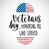 Happy Veterans Day lettering for your design. Vector illustration of calligraphy phrase Happy Veterans Day 11 november and USA flag in shape of heart on blue Royalty Free Illustration
