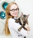 Happy veterinarian  hugs cat Royalty Free Stock Photo