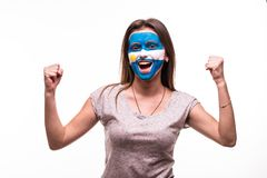 Happy victory scream woman fan support Argentina national team with painted face isolated on white background. Happy victory scream woman fan support Argentina stock images