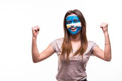 Happy victory scream woman fan support Argentina national team with painted face isolated on white background. Happy victory scream woman fan support Argentina stock photo