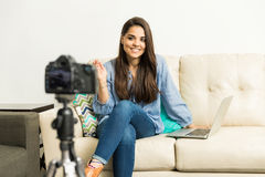 Happy video blogger greeting audience Royalty Free Stock Image