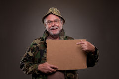 Happy Vietnam Veteran showing a cardboard piece Royalty Free Stock Photo