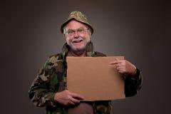 Happy Vietnam Veteran showing a cardboard piece Royalty Free Stock Photo