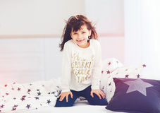 Happy vigorous young girl wakes up in the morning sun light, cut. E toothless smile at home Stock Images