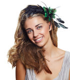 Happy vintage bride. Happy beautiful woman with long blond hair in big hairstyle, wearing flower headband with green and black feathers on white background royalty free stock photo
