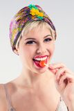Happy vintage girl with candy Stock Photography