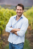 Happy vintner with crossed arms Royalty Free Stock Image