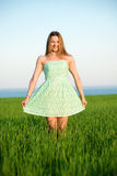 Happy vitality freedom girl stands with her hands. Happy playfull vitality freedom girl stands in green field. Woman lifestyle Royalty Free Stock Photos