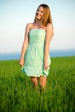 Happy vitality freedom girl stands with her hands. Happy playfull vitality freedom girl stands in green field. Woman lifestyle Royalty Free Stock Image