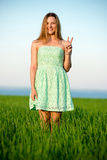 Happy vitality freedom girl stands with her hands. Playfull woman. Happy playfull vitality freedom girl stands in green field. Woman lifestyle Stock Photos