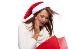 Happy vivacious Christmas shopper Royalty Free Stock Image