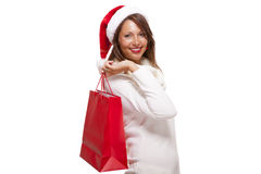 Happy vivacious Christmas shopper Stock Image