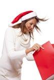Happy vivacious Christmas shopper Royalty Free Stock Image