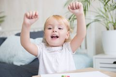 Happy vivacious little girl cheering Stock Photo