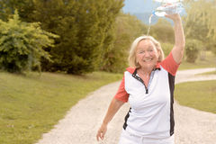 Happy vivacious woman cooling down with water Royalty Free Stock Photos