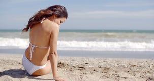 Happy vivacious woman on a tropical beach stock video