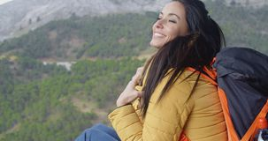 Happy vivacious young woman backpacker stock video footage