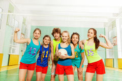Happy volleyball players after match in gymnasium Stock Photos