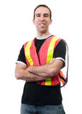 Happy Volunteer. A smiling young man wearing a reflective vest, isolated against a white background Stock Photos