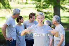 Happy volunteer blonde smiling at the camera Royalty Free Stock Images