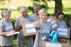 Happy volunteer blonde with thumb up Stock Photos