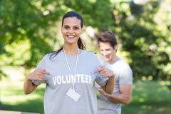 Happy volunteer brunette smiling at the camera Stock Images