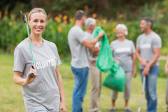 Happy volunteer collecting rubbish Royalty Free Stock Images
