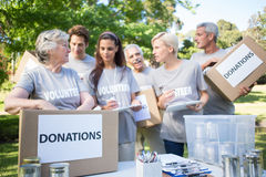 Happy volunteer family holding donation boxes Royalty Free Stock Images