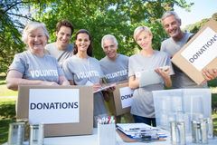 Happy volunteer family holding donation boxes Royalty Free Stock Photos