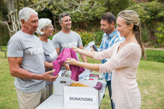 Happy volunteer family separating donations stuffs royalty free stock photo