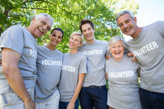 Happy volunteer family smiling at the camera Royalty Free Stock Images