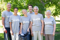 Happy volunteer family smiling at the camera Royalty Free Stock Image