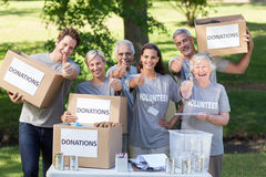 Happy volunteer family with thumbs up Stock Images