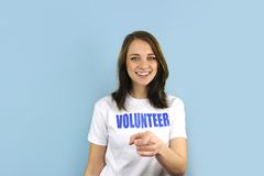 Happy volunteer girl pointing at you Royalty Free Stock Images