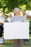 Happy volunteer grandmother holding blank Stock Images