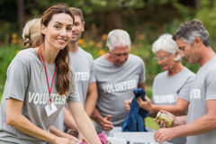 Happy volunteer looking at donation box Royalty Free Stock Images