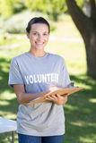 Happy volunteer in the park Royalty Free Stock Photography