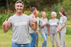 Happy volunteer showing his t-shirt to camera Royalty Free Stock Photos