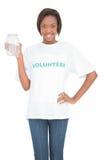 Happy volunteer woman holding glass jar Royalty Free Stock Image