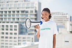 Happy volunteer woman holding megaphone Royalty Free Stock Image