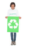 Happy volunteer woman holding recycling sign Stock Images