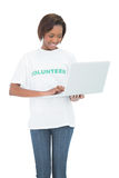 Happy volunteer woman using laptop Royalty Free Stock Photos