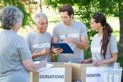 Happy volunteer writing on clipboard Royalty Free Stock Images