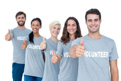 Happy volunteers friends gesturing thumbs up Royalty Free Stock Photo