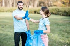 Happy volunteers in the paark stock photos